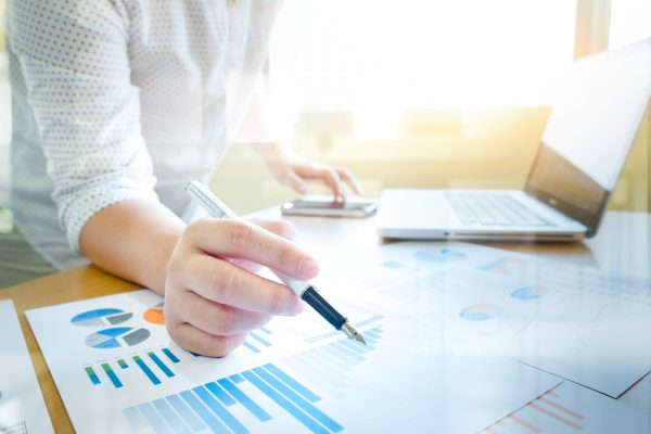 Working business people analyse high performance marketing data